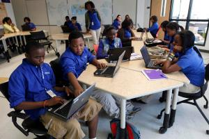 "In this May 20, 2010 photo, students use laptop computers in the classroom at the ""School of the Future"" in Philadelphia. (AP Photo/Matt Rourke)"